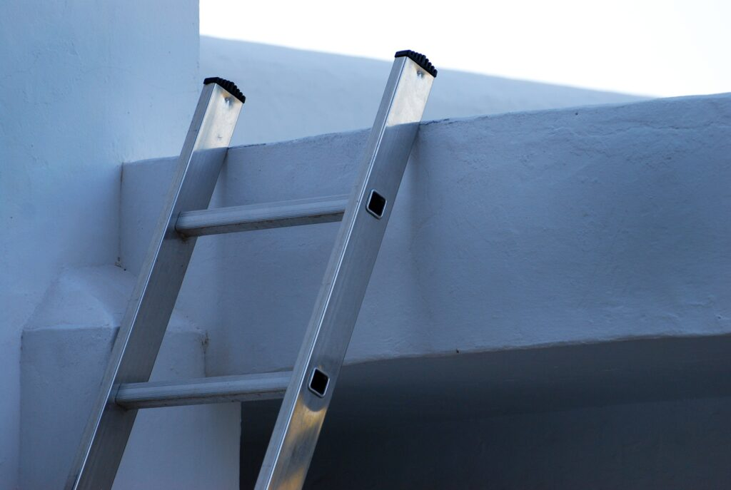 Ladder leaning against a roof