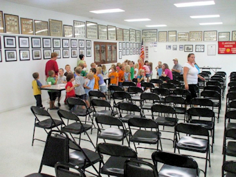 People, chairs and Tables in the hall